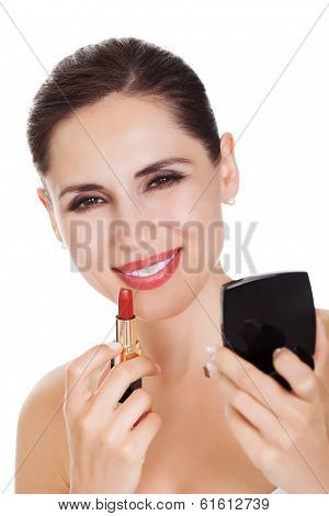 Attractive Woman Applying Lipstick