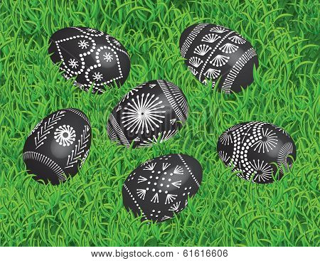 Decorated Black Easter Eggs on the Bed of Grass