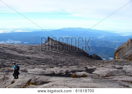 Unidentified man climbing mountain