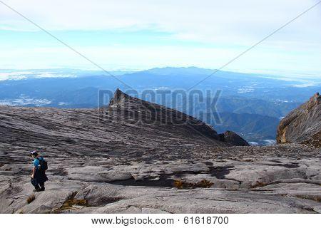 Unidentified man climbing mountain