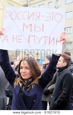 MOSCOW - MARCH 15: Young woman with the poster