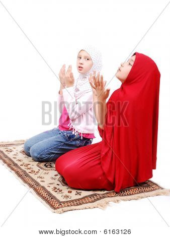 Two Little Muslim Girls Praying