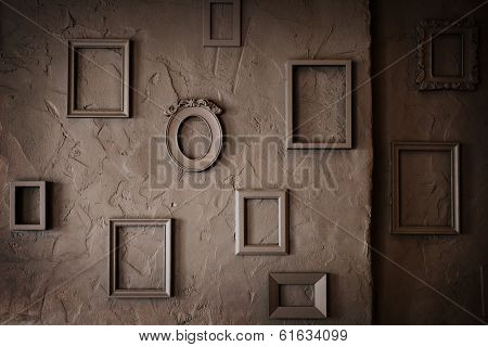 Blank Empty  Photo Frames on a  rough Grungy Background