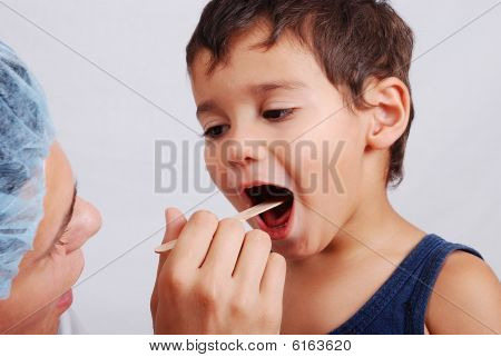 A Dentist And Cute Kid With Opened Mouth