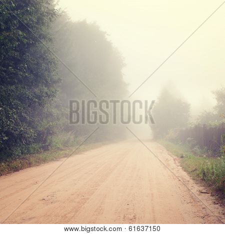 Autumn Landscape with Road in Fog