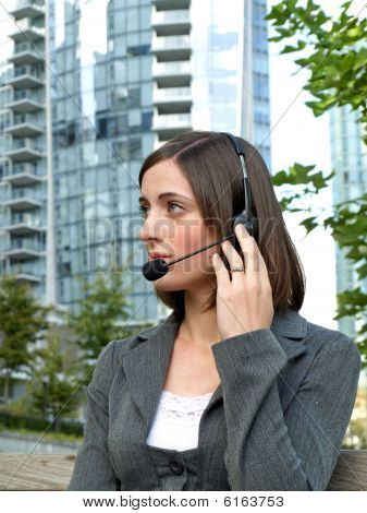 Young businesswoman with headset