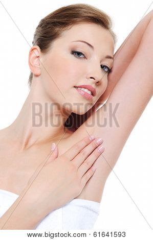 Portrait of pretty woman stroking her clean fresh armpit