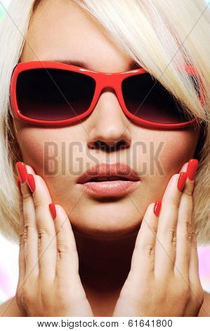 close-up portrait of young female face in fashion red sunglasses