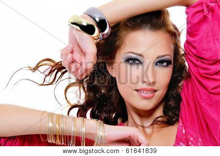 Close-up portrait of pretty beautiful woman with bright make-up and stylish bracelet