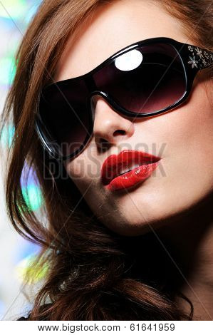 Portrait of beautiful pretty female face with glamour fashion sunglasses on it