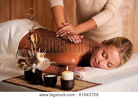 professional masseur doing massage of female back in the beauty salon