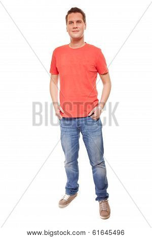 Young Man Guy Red T-shirt Jaens With Hands In Pockets Isolated