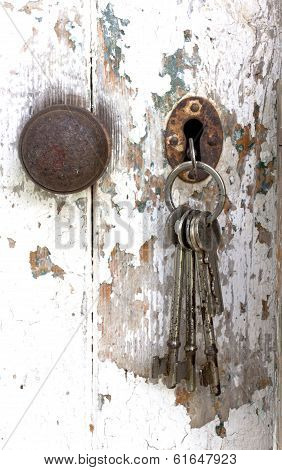 Bunch Of Keys Hanging From Peeling Shed Door