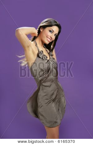 Brunette Dancing At Studio On Purple Background