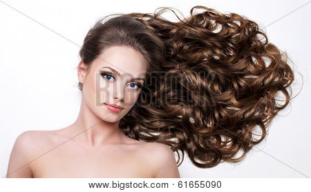 Beautiful woman with long beauty hairs - on  white background