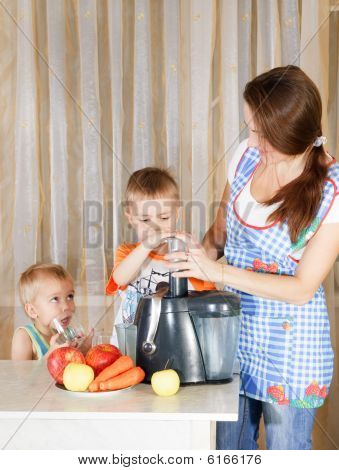 Mother With Two Kids Doing Juice