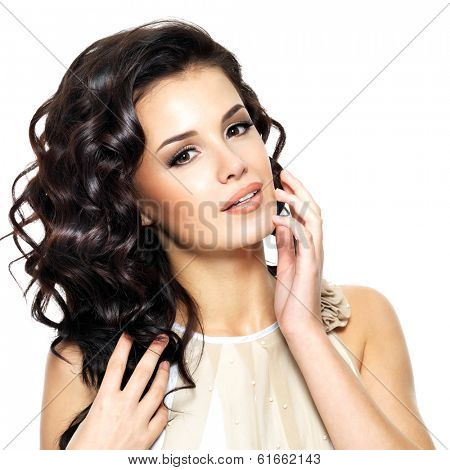 Beautiful  young woman with beauty long curly hair. Fashion model portrait isolated on white background