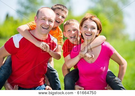 Happy family with two children on nature - happiness concept