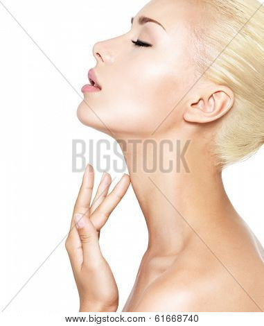 Portrait of the beautiful woman who touches the neck by fingers - isolated on white
