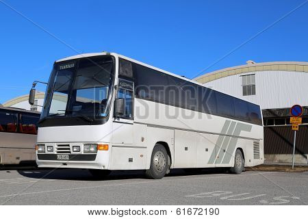 White Coach Bus In Front Of Sports Hall