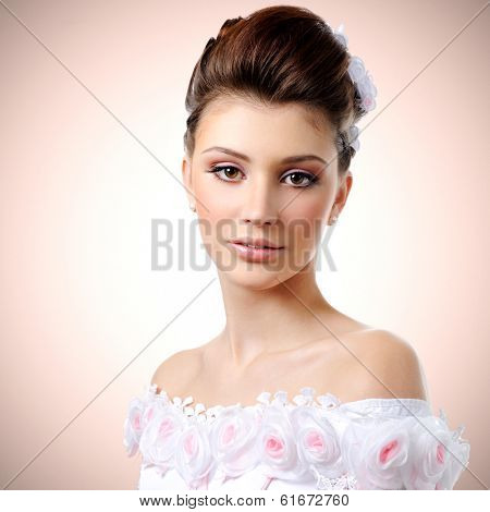 Portrait of young beauty bride with style hairstyle and make-up