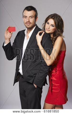 Fashion couple with blank credit card