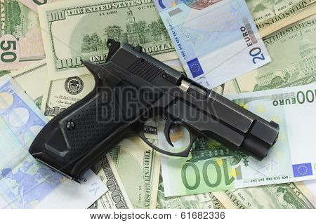 money as a backdrop and a gun