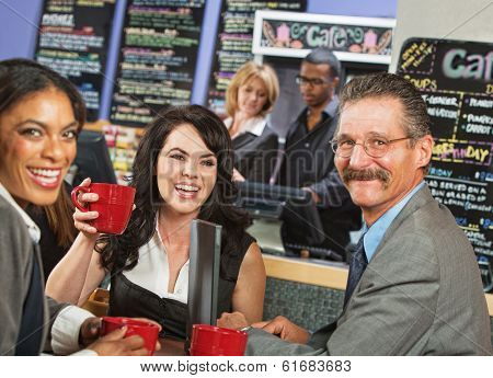 Smiling Business People In Cafe