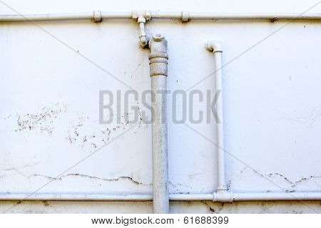 Water And Drainage Pipes On Exterior Wall