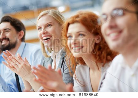Image of a business team applauding in the sign of approval