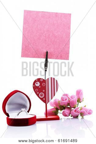 Empty note paper attached to message holder isolated on white