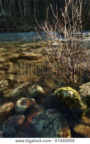 Sunlit rocks underwater at sunset
