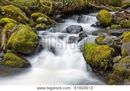Waterfall with mossy rocks and silky water effect