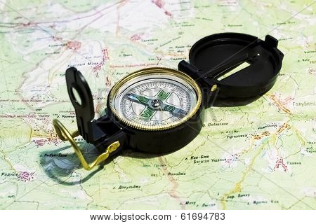 Compass Lies On The Terrain Map