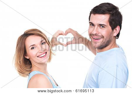 Portrait of cheerful smiling couple standing together show hands heart -  isolated on white background.