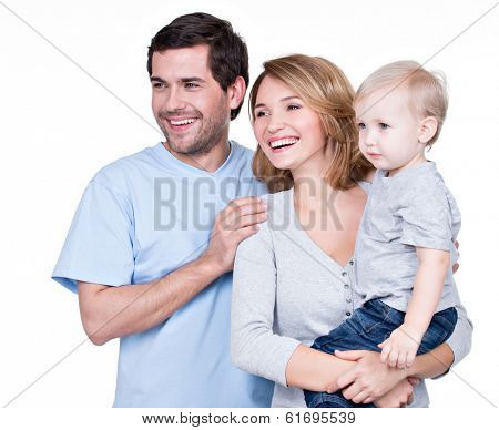 Portrait of the happy family with little child looking sideways - isolated on white background.