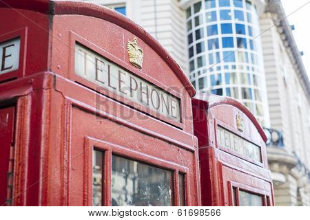 Detail of old red telephone booth in London, UK