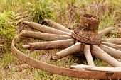 stock photo of chariot  - old broken wagon wheel in the field  - JPG