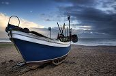 Fishing Boat On Beach Landscape With Stormy Sky