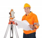 stock photo of theodolite  - Portrait of Senior land surveyor working with theodolite - JPG