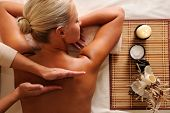 stock photo of backbone  - Woman getting  recreation massage in spa salon  - JPG
