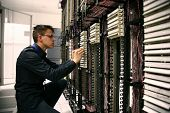 stock photo of cisco  - IT Engineer Configuring Hardware