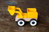 picture of dozer  - Simple wheel dozer toy plastic and wood - JPG