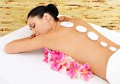 foto of backbone  - Body care for young woman at beauty spa salon - JPG