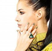 stock photo of precious stones  - Pretty woman with golden nails and beautiful precious stone emerald  - JPG