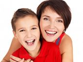 image of backround  - Happy laughing young mother with son 8 year old over white background - JPG