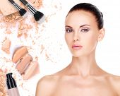 stock photo of cosmetic products  - Model face of beautiful woman with foundation on skin make - JPG
