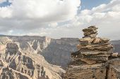 pic of jabal  - Pile of stones shaped like a pyramid on the edge of a cliff - JPG