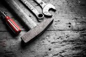 foto of vanadium  - different tools on an old wooden table - JPG