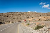 foto of jabal  - Ascending mountain road with blue sky - JPG